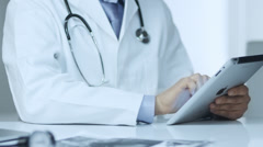 Doctor Using Digital Tablet PC at Work - stock footage
