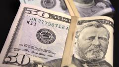 Wads of cash US currency - stock footage