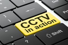 Protection concept: CCTV In action on computer keyboard - stock illustration