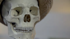 Skull with a hat speaks about something Stock Footage