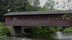 Henry Bridge in Bennington Vermont VT 1840 red old historical over the river Stock Footage