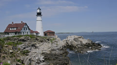 Famous Portland Head Light lighthouse in Portland Maine in bright sunshine sunny Stock Footage