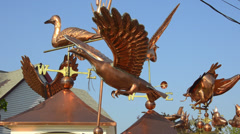Colorful copper weathervanes for sale in Wells Maine Stock Footage