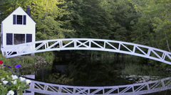 Beautiful lonely isolated curved bridge over water in Somesville Maine Stock Footage