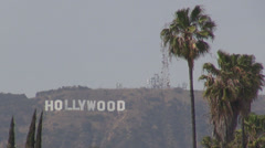 Hollywood sign background mountain hill medis star movie palm tree fog cloudy US Stock Footage