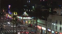 Aerial view traffic street car pass pedestrian walkway walk fame night LA USA US Stock Footage