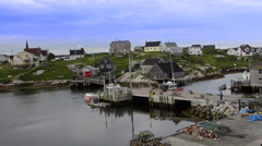 Beautiful village of Peggys Cove with harbour and fishing sheds in Nova Scotia - stock footage