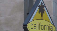 California road sign street traffic travel tourist attraction yellow palm tree  Stock Footage
