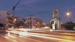 4K Athens gate of Hadrian Roman ruins night traffic timelapse Stock Footage