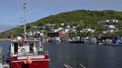 Stock Video Footage of Newfoundland Canada St Johns capital at famous Petty Harbour with colorful ships