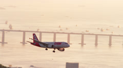 An airplane comes into land at Santos Dumont Airport. Stock Footage