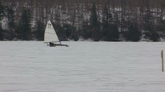 Ice sailing on frozen lake in cold winter Stock Footage