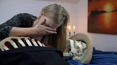 Crying over the skeleton of a dead body Stock Footage