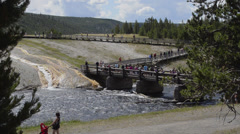 Yellowstone National Park in Wyoming tourists at Lower Geyser Basin on walkway Stock Footage