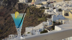 Blue Martini on deck of white resort in Fira the main town of Santorini in the Stock Footage