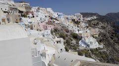 Santorini Greece and the beautiful white buildings on the mountain cliffs of the Stock Footage