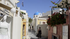 Oia Santorini Greece and the relaxed vacation with shoppers on main streets Stock Footage