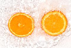 Orange in water on white background Stock Photos