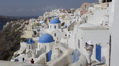 Athens Greece Woman Tourist along White Buildings of Oia in Santorini Greece Stock Footage