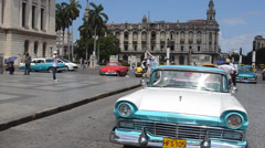 Classic American 50s Ford automobiles in view of busy streets of Havana Habana Stock Footage