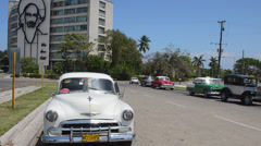 Havana Habana Cuba old classic American cars with Coco taxi passing by in Stock Footage