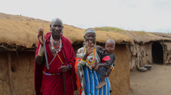 Amboseli National Park Kenya Africa safari Masai couple with child welcome to Stock Footage