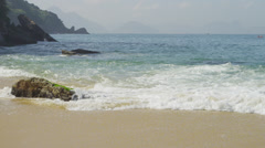 Slow motion of waves ebbing and flowing on the sand at Rio's Red Beach. Stock Footage