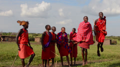 Kenya Masai Mara Masai warriors doing traditional jumping for tourists in Masai Stock Footage