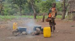 Turmi Ethiopia Africa village Lower Omo Valley tribal tribe Bena village woman Stock Footage