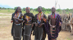 Arbore Tribe Ethiopia Africa Erbore tribal village Lower Omo Valley young girls Stock Footage