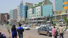 Addis Ababa Ethiopia Africa modern city buildings with traffic circle and action Stock Footage