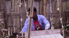 Arba Minch Chencha Ethiopia Africa Dorze tribe village local man weaving scarf Stock Footage