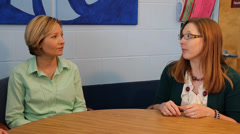 two teachers talking with principal two shot - stock footage