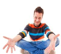 man showing helplessness by a gesture of his hands isolated on white - stock photo