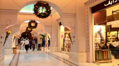 Shoppers in large Mall of the Emirates in Dubai in the UAE with shops and muslim Stock Footage