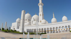 Fountains at the beautiful white Sheikh Zayed Grand Mosque in Abu Dhabi in the Stock Footage