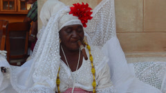Havana Cuba Santeria woman local with Tarot cards and cigar for future readings Stock Footage