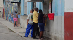Havana Cuba Hamel Street Alley people getting cold drinks from a storefront Stock Footage