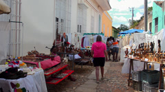 Trinidad Cuba shoppers and vendors in side street selling goods Stock Footage