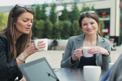 Businesswoman smiling to camera in street cafe, steadycam shot Stock Footage
