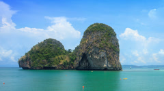 Timelapse of beautiful limestone formations of thailand with traditional boats Stock Footage
