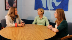 Teachers talking with principal Stock Footage