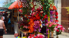 Sancti Spiritus Cuba downtown flowers for sale shopping along stores in Stock Footage