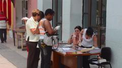 Sancti Spiritus Cuba downtown walking street with women selling books in Stock Footage