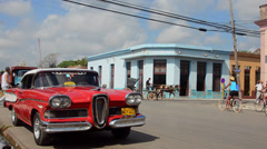Cardenas Cuba old Classic 1950s Edsel parked downtown on street with traffic Stock Footage