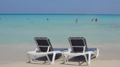 Varadero Cuba the perfect beach blue waters and chairs waiting for tourists to Stock Footage