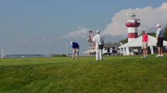 Golfers on 18th Hole at exclusive Habour Town Golf Links in Hilton Head South Stock Footage
