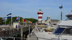 Hilton Head South Carolina the pier with yachts at Harbour Town with famous red - stock footage