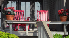 Scenic of  red Adronidack chairs at  Habour Town in Hilton Head South Carolina Stock Footage
