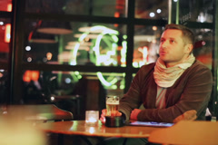 Couple having a date in a pub at night, steadycam shot Stock Footage